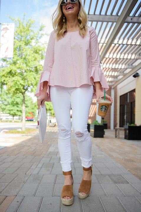 blush pink bell sleeve top and white jeans for spring