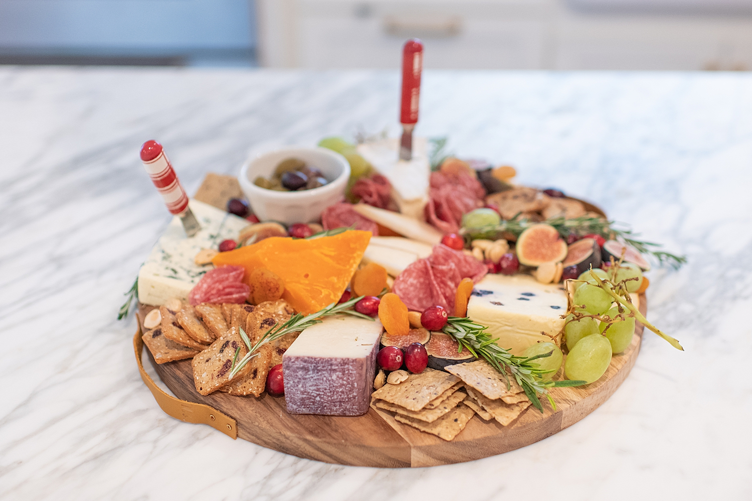 Top Houston life and style blogger, Fancy Ashley, features her tips to prepare the perfect Charcuterie Tray for the Holidays: image of a festive charcuterie tray