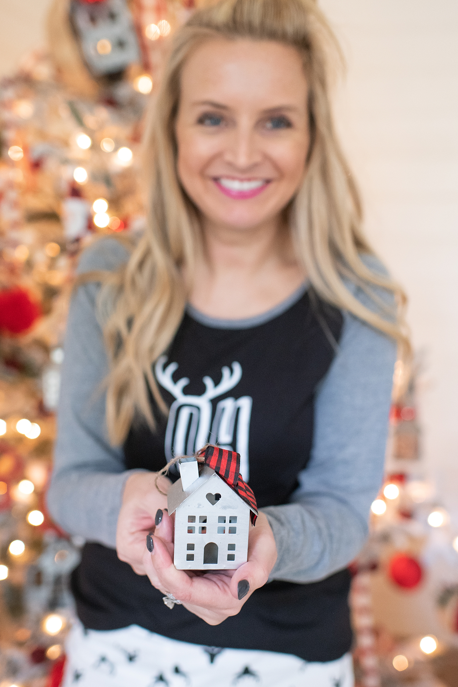 """Holiday Pjs & Top Macy's Christmas Gifts featured by top Houston life and style blog, Fancy Ashley"""" image of a woman wearing Holiday pjs and grey slippers available at Macy's"""