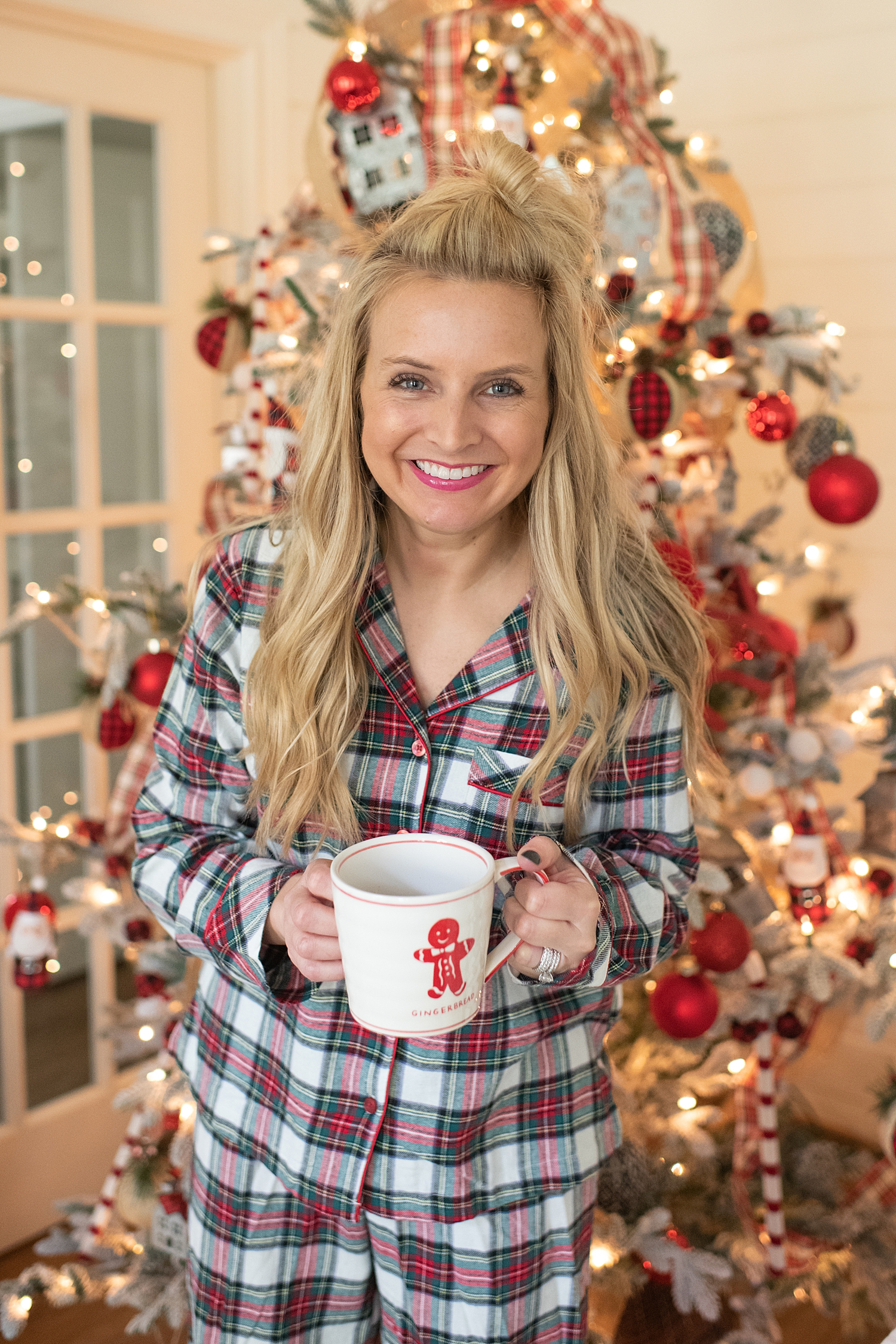 """Holiday Pjs & Top Macy's Christmas Gifts featured by top Houston life and style blog, Fancy Ashley"""" image of a woman wearing plaid Holiday pjs and grey slippers available at Macy's"""