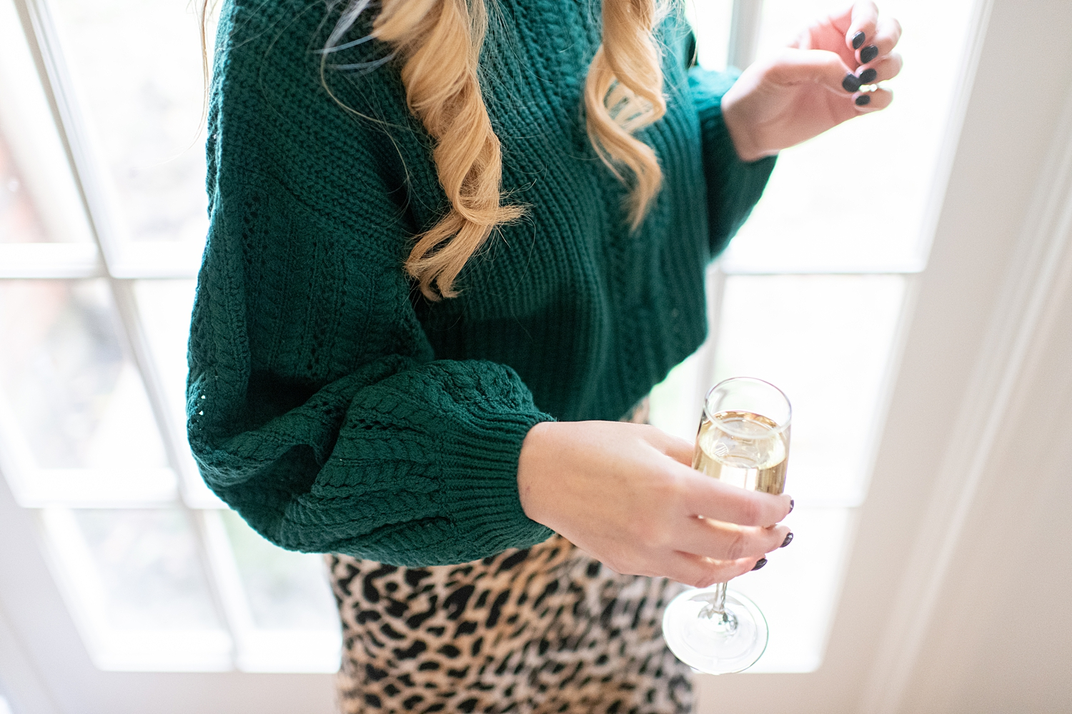 Fancy Ashley x Social Threads collection featured by top Houston fashion blogger, Fancy Ashley: image of a woman wearing a Social Threads Leopard skirt and green sweater