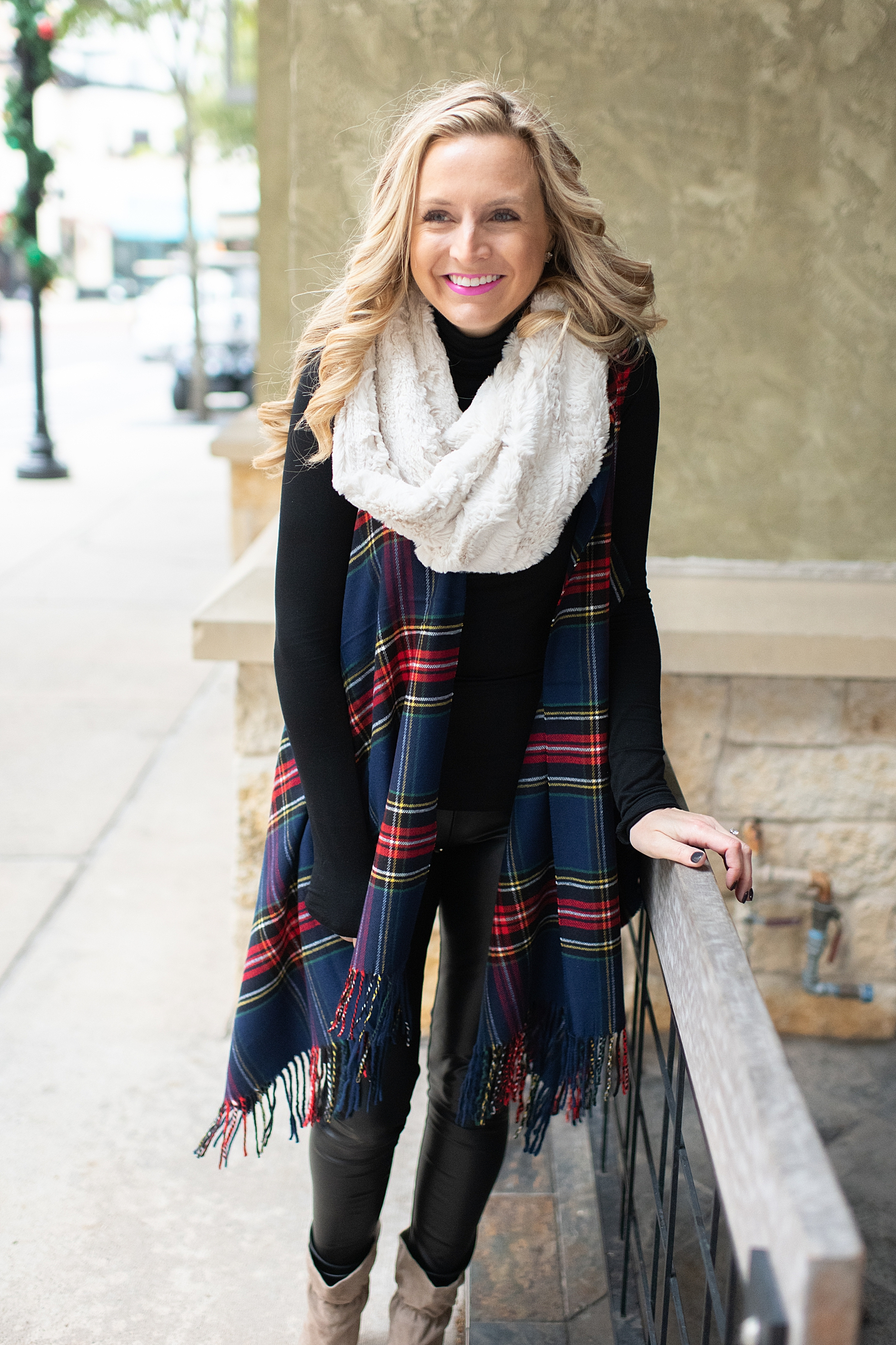 Fancy Ashley x Social Threads collection featured by top Houston fashion blogger, Fancy Ashley: image of a woman wearing a Social Threads plaid vest, Social Threads faux leather leggings, black turtleneck, Social Threads quilted clutch, Social Threads white infinity scarf and Sole Society booties