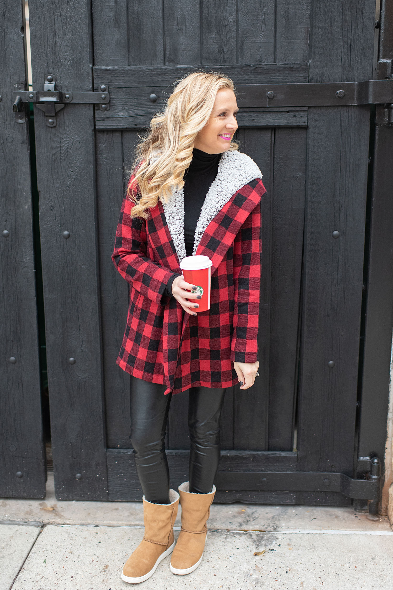Fancy Ashley x Social Threads collection featured by top Houston fashion blogger, Fancy Ashley: image of a woman wearing a Social Threads plaid coat, Social Threads faux leather leggings, and UGG sneakers