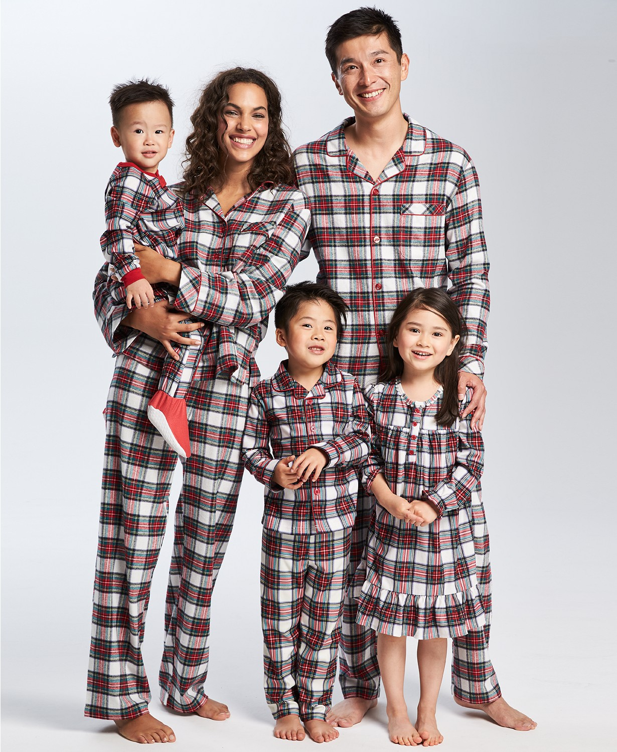 """Holiday Pjs & Top Macy's Christmas Gifts featured by top Houston life and style blog, Fancy Ashley"""" image of a family wearing plaid holiday pjs available at Macy's"""