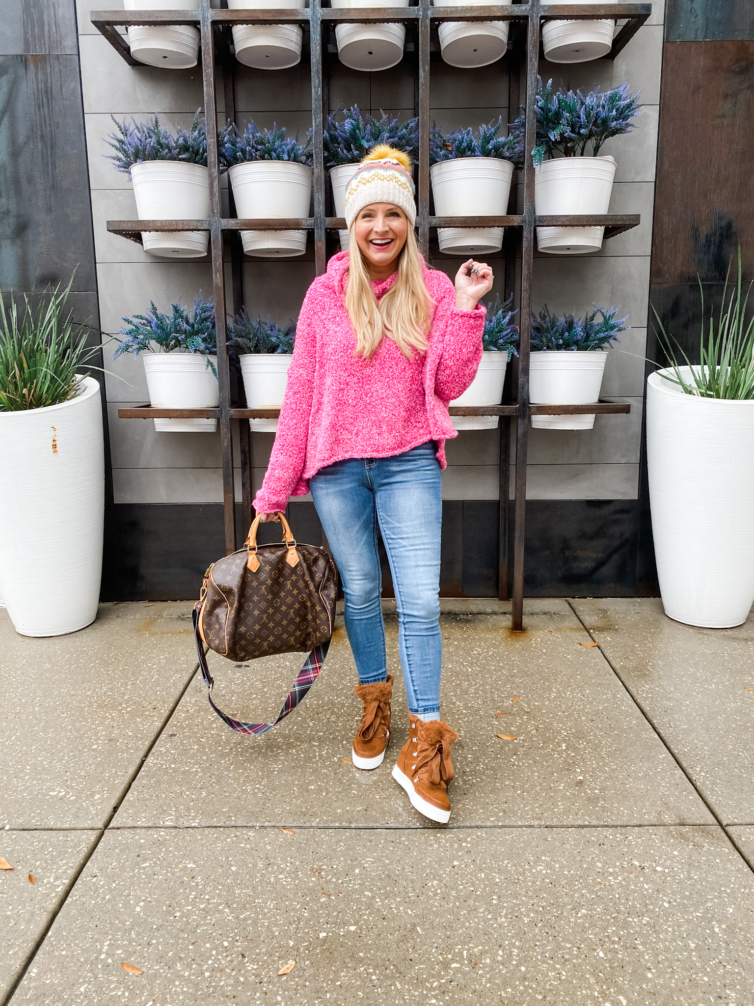 After Christmas Sales by popular Houston life and style blog, Fancy Ashley: image of a woman standing outside and wearing a cream pom beanie, pink hoodie sweater, jeans, and brown suede high top sneakers.