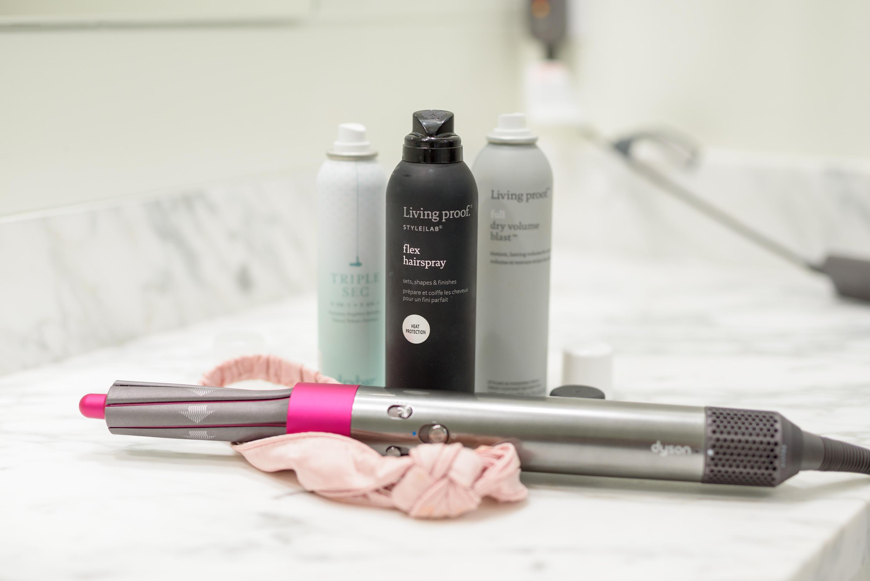 Fall Beauty by popular Houston beauty blog, Fancy Ashley: image of a Dyson hair wand, Living Proof flex hairspray, Living Proof dry volume blast, and dry bar triple sec dry shampoo.