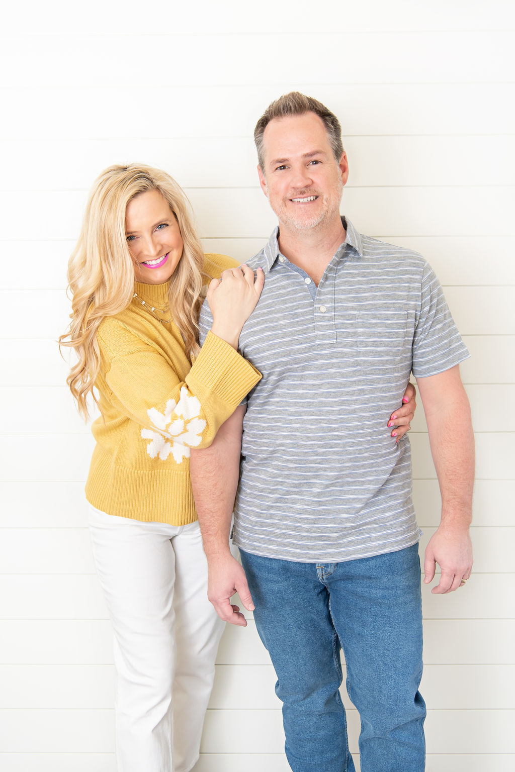 Little Black Dresses by popular Houston fashion blog, The House of Fancy: image of a man and woman standing together and wearing a grey and white stripe polo, jeans, grey sneakers, yellow and white floral print sweater, white pants, and white sneakers.