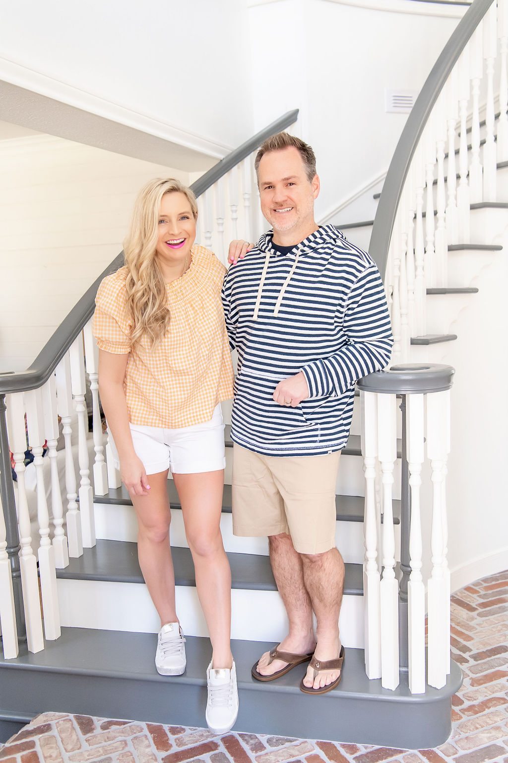 Little Black Dresses by popular Houston fashion blog, The House of Fancy: image of a man and woman standing together and wearing a blue and white stripe hoodie, tan shorts, brown sandals, orange gingham top, white shorts, and white sneakers.