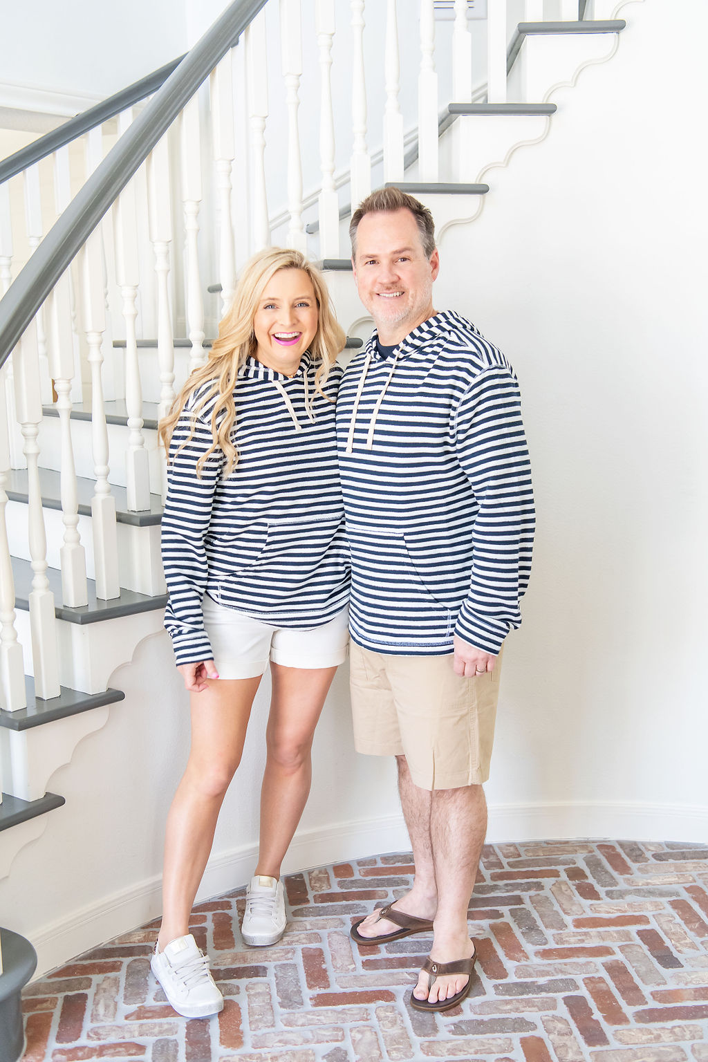 Little Black Dresses by popular Houston fashion blog, The House of Fancy: image of a man and woman standing together and wearing a blue and white stripe hoodie, tan shorts, brown sandals, white shorts, and white sneakers.