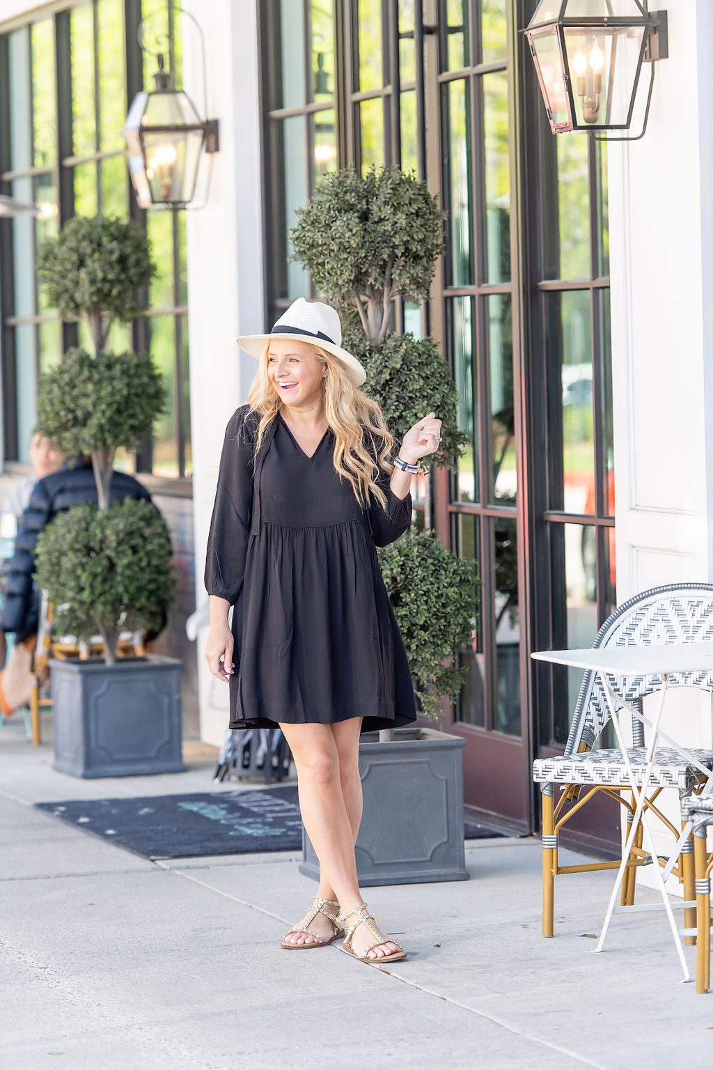 Little Black Dresses by popular Houston fashion blog, The House of Fancy: image of a woman wearing a black baby swing dress, white fedora hat, and studded strap sandals.