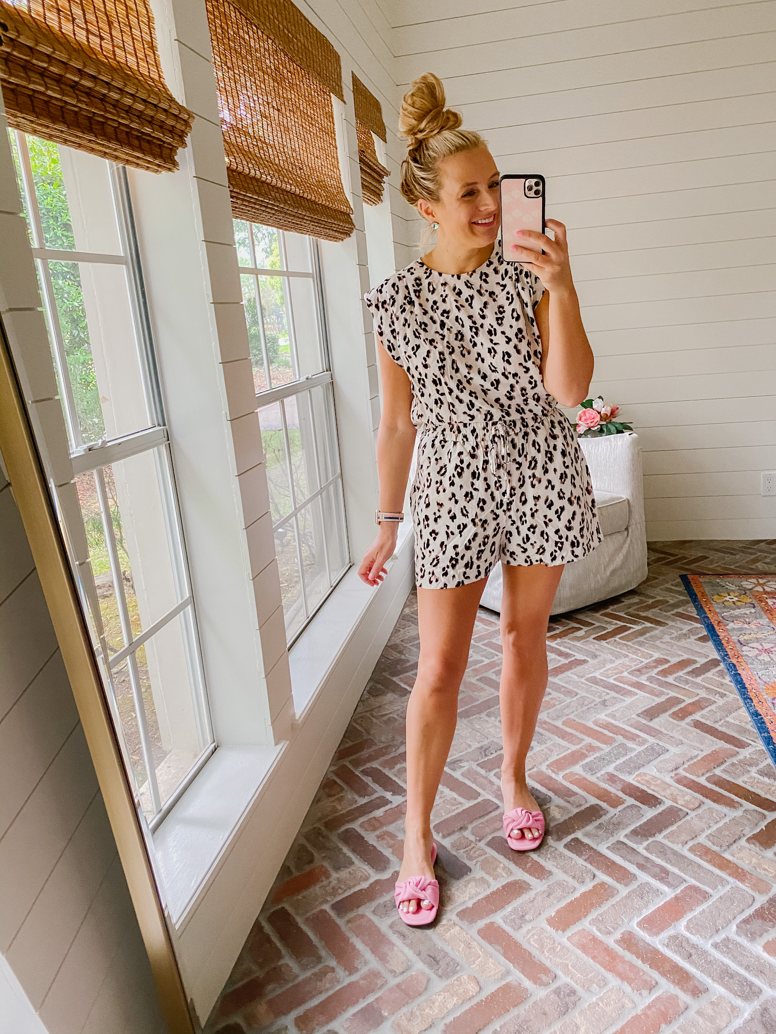Express New Arrivals by popular Houston fashion blog, The House of Fancy: image of a woman wearing a Express leopard print top and Express leopard print shorts with pink slide sandals.