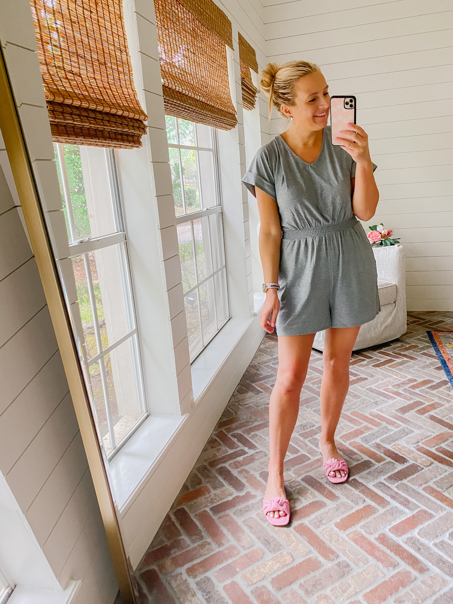 Express New Arrivals by popular Houston fashion blog, The House of Fancy: image of a woman wearing a Express grey romper with pink slide sandals.