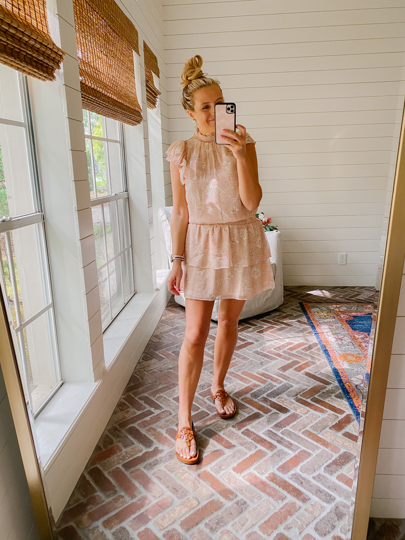 Express New Arrivals by popular Houston fashion blog, The House of Fancy: image of a woman wearing a Express peach colored floral print mock neck and tiered ruffle skirt mini dress with brown slide sandals.