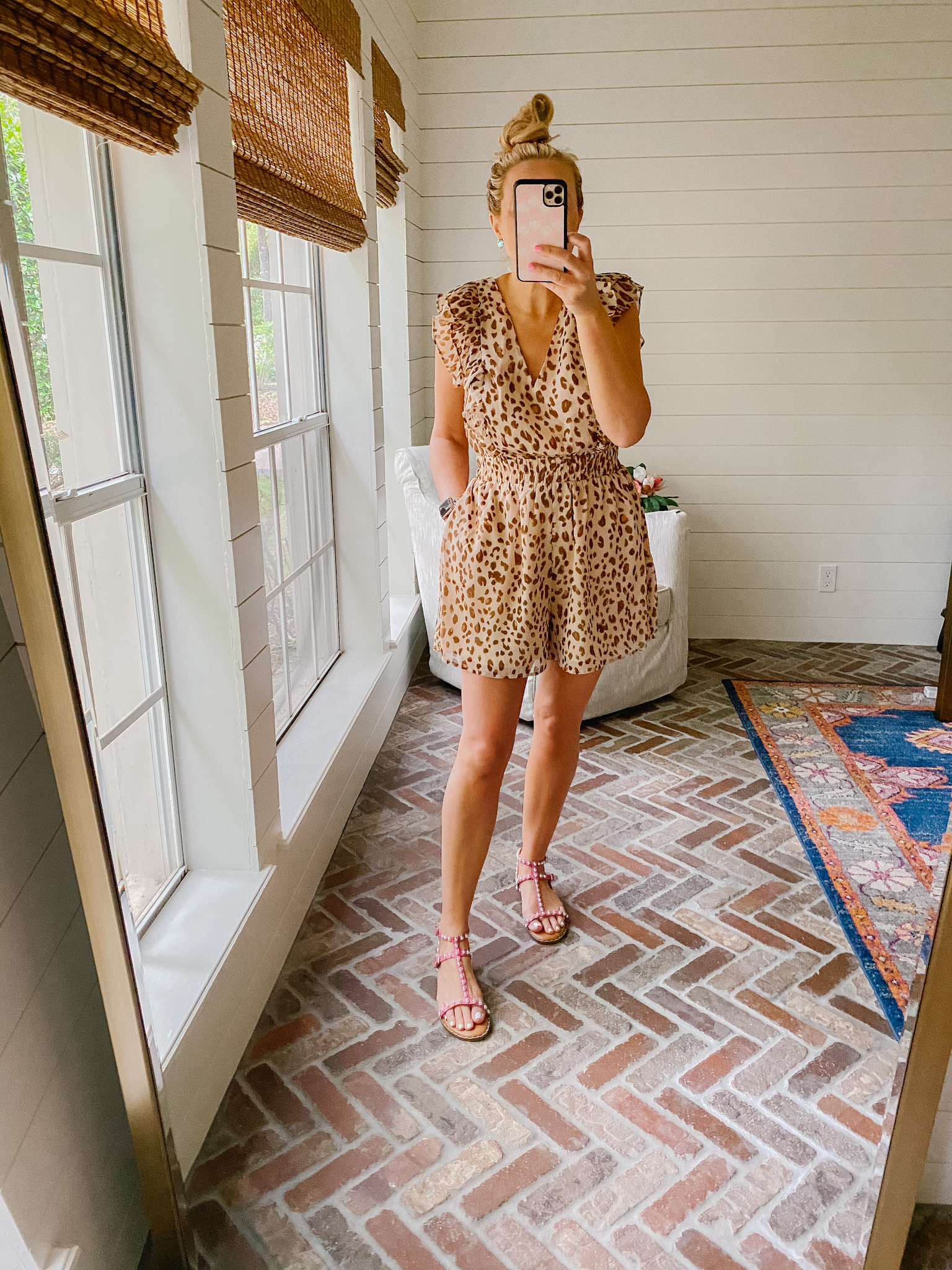Express New Arrivals by popular Houston fashion blog, The House of Fancy: image of a woman wearing a Express leopard print romper and pink strap sandals.