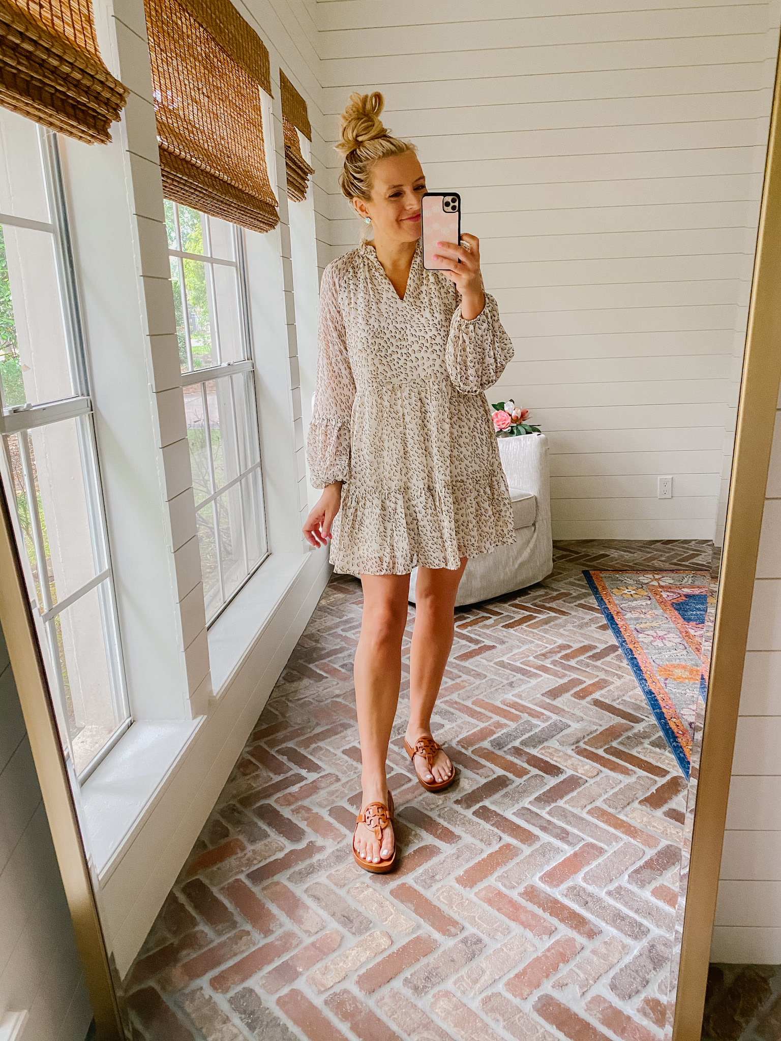 Express New Arrivals by popular Houston fashion blog, The House of Fancy: image of a woman wearing a Express leopard print dress with brown slide Tory Burch sandals.