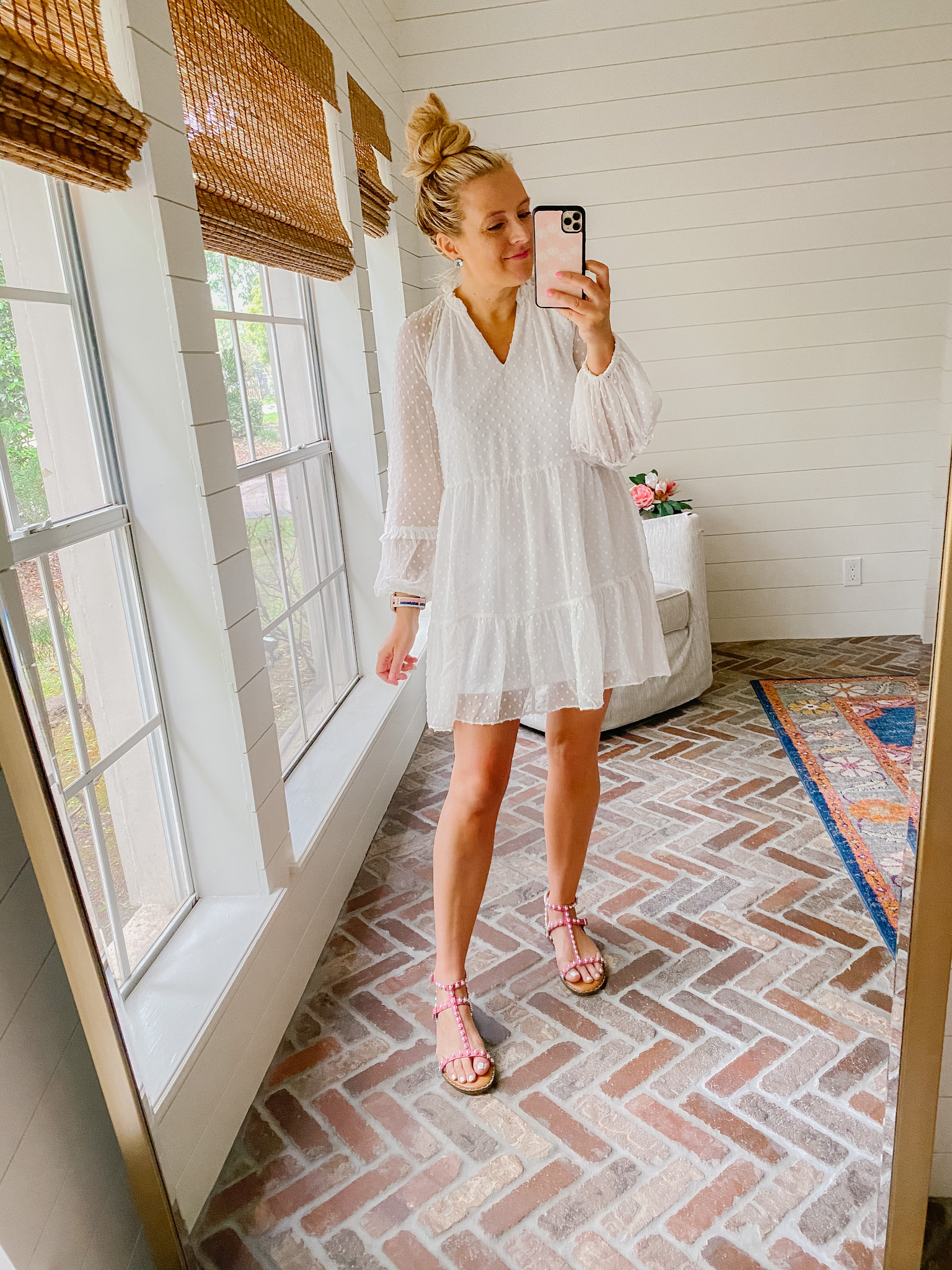 Express New Arrivals by popular Houston fashion blog, The House of Fancy: image of a woman wearing a Express white Swiss dot dress with pink strap sandals.