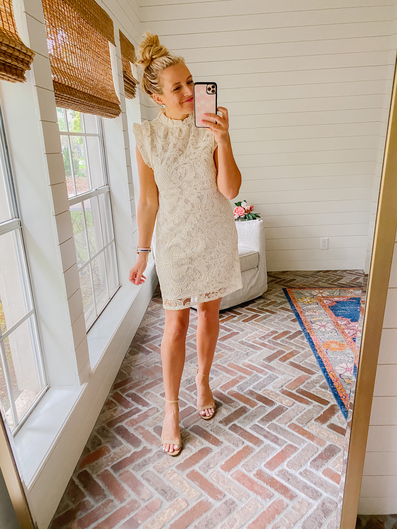 Express New Arrivals by popular Houston fashion blog, The House of Fancy: image of a woman wearing a Express cream lace mock neck dress with tan block heel sandals.