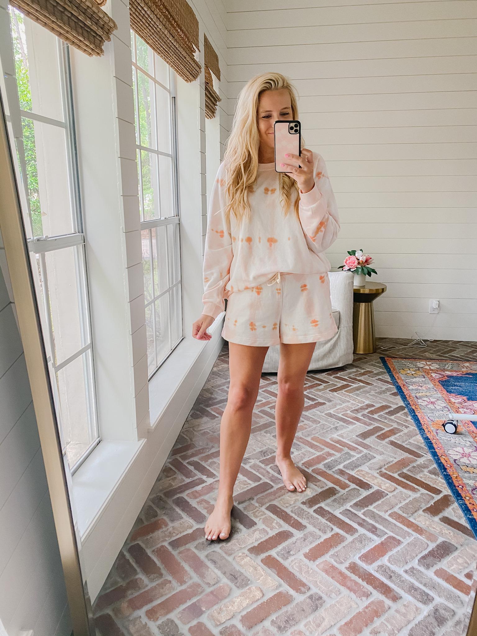 Loft Clothing by popular Houston fashion blog, The House of Fancy: image of a woman wearing a Loft orange and pink tie dye loungewear set.