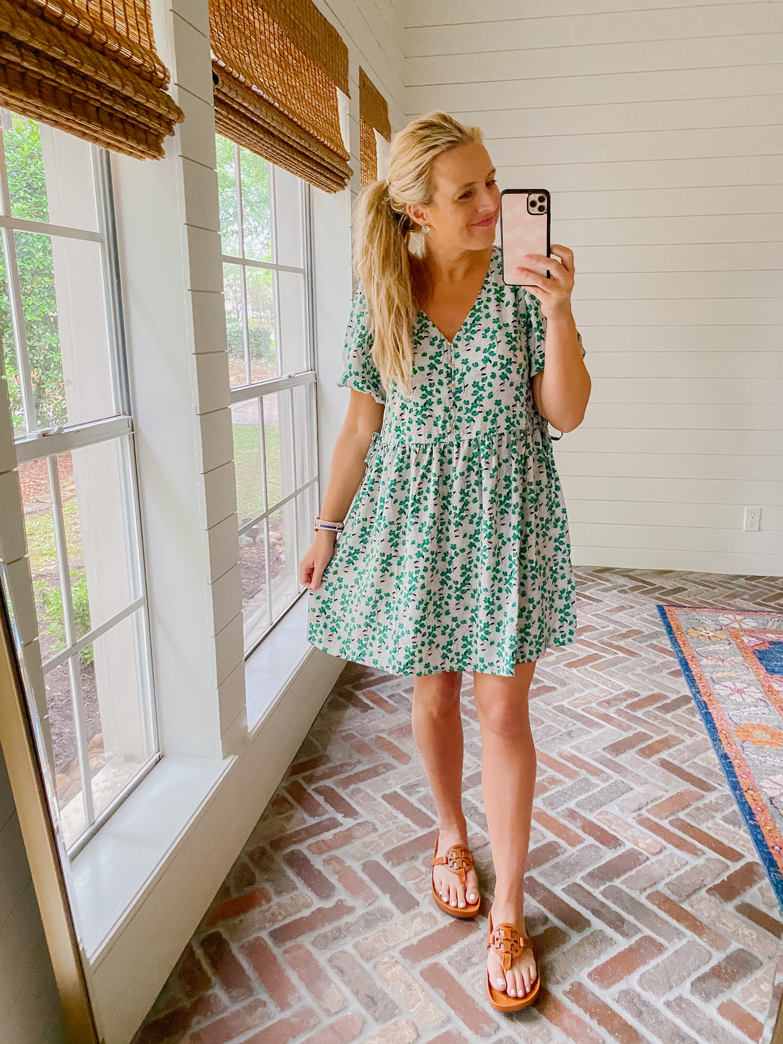 Loft Clothing by popular Houston fashion blog, The House of Fancy: image of a woman wearing a Loft green and white floral print dress with brown Tory Burch slide sandals.