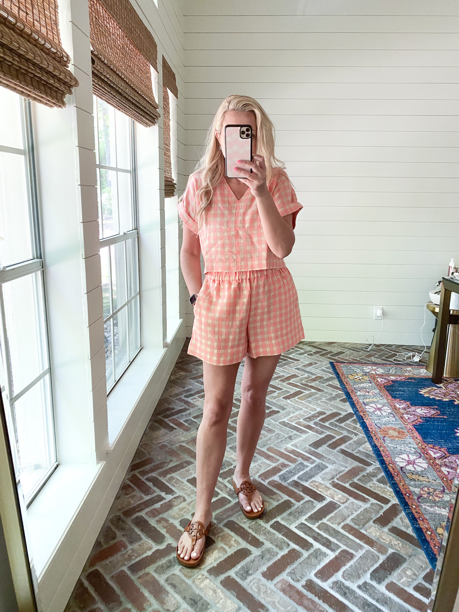 Loft Clothing by popular Houston fashion blog, The House of Fancy: image of a woman wearing a Loft pink and cream gingham shirt and short set with brown Tory Burch slide sandals.