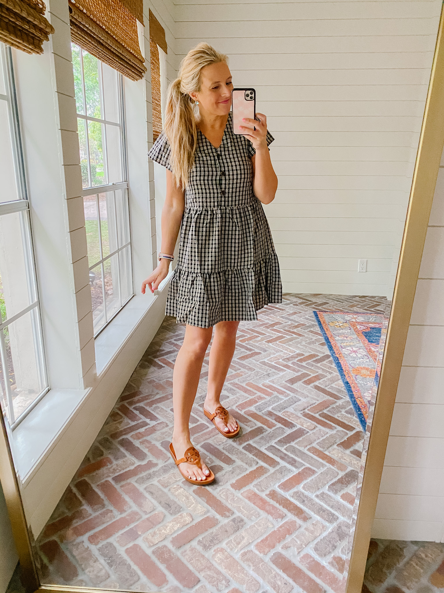 Loft Clothing by popular Houston fashion blog, The House of Fancy: image of a woman wearing a Loft black and white plaid dress with brown Tory Burch slide sandals.