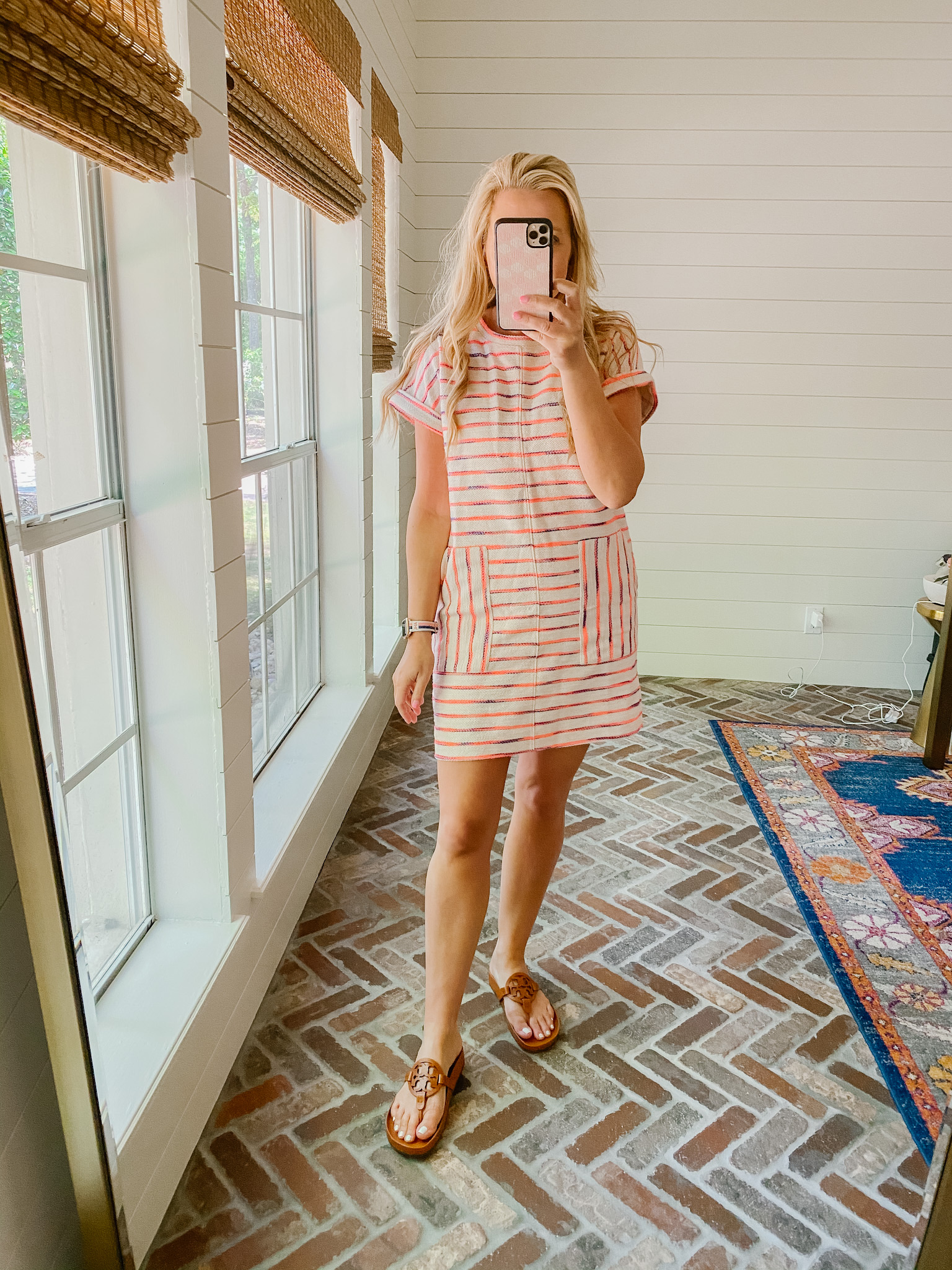 Loft Clothing by popular Houston fashion blog, The House of Fancy: image of a woman wearing a Loft stripe dress with pockets and brown Tory Burch slide sandals.