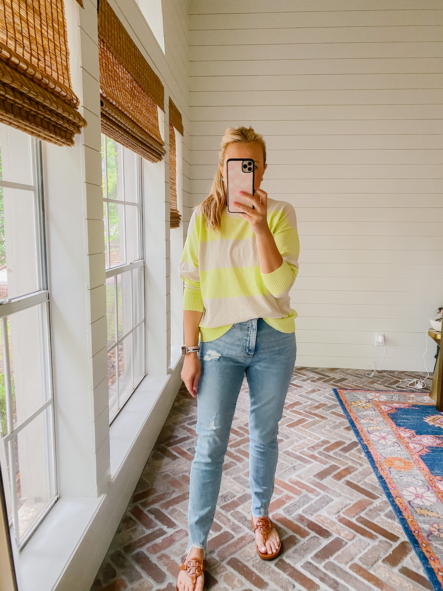 Loft Clothing by popular Houston fashion blog, The House of Fancy: image of a woman wearing a Loft yellow and tan stripe sweater with light wash distressed denim and brown Tory Burch slide sandals.