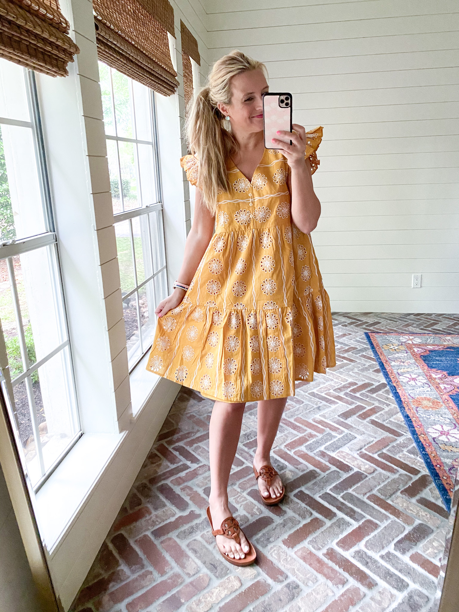 Loft Clothing by popular Houston fashion blog, The House of Fancy: image of a woman wearing a Loft yellow and white eyelet dress with brown Tory Burch slide sandals.