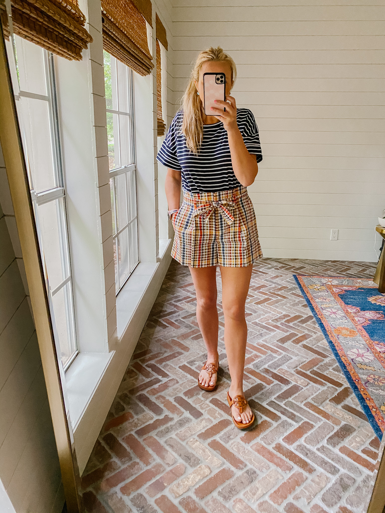 Loft Clothing by popular Houston fashion blog, The House of Fancy: image of a woman wearing a Loft blue and white stripe top, plaid paper bag shorts, and brown Tory Burch slide sandals.