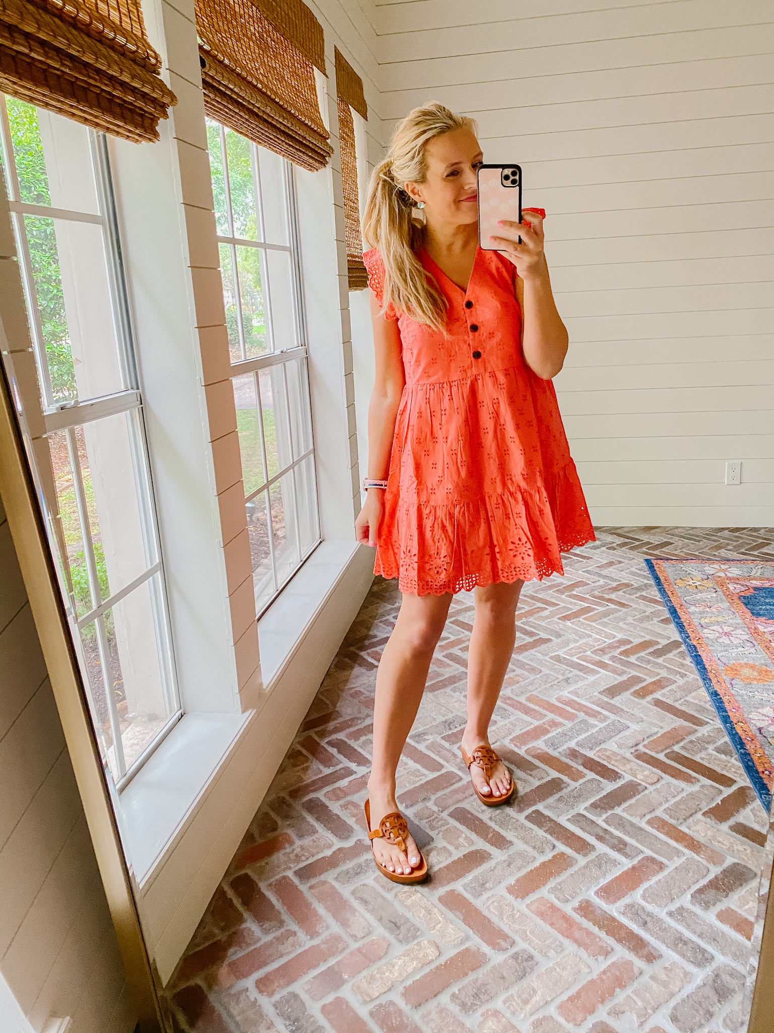 Loft Clothing by popular Houston fashion blog, The House of Fancy: image of a woman wearing a red Loft eyelet dress with brown Tory Burch slide sandals.