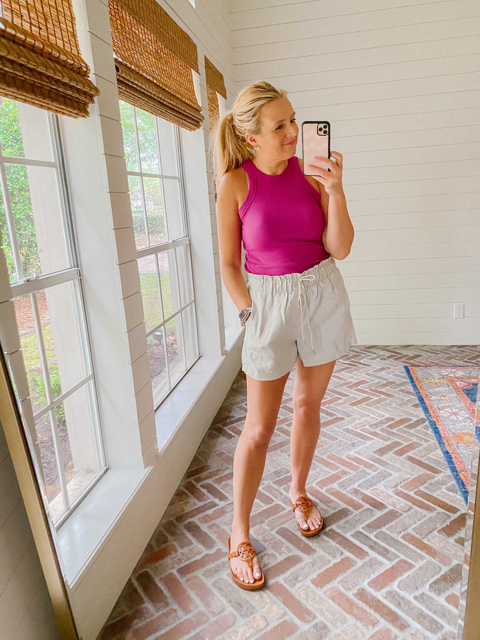Loft Clothing by popular Houston fashion blog, The House of Fancy: image of a woman wearing a Loft pink tank, Loft tan tie waste shorts, and brown Tory Burch slide sandals.