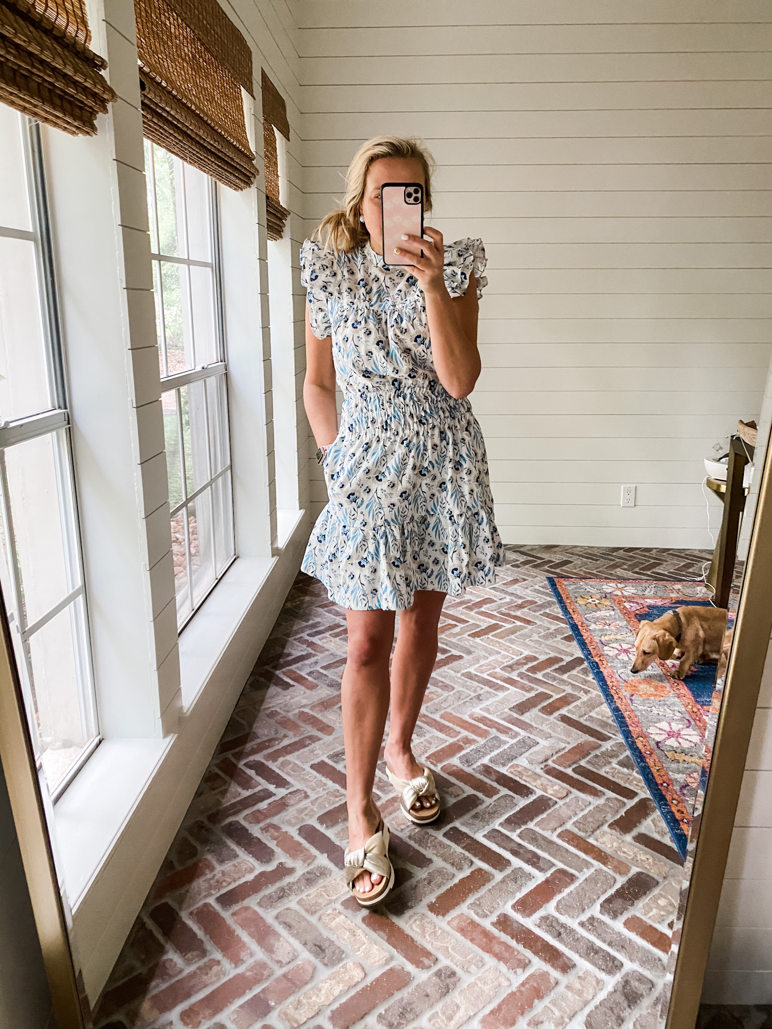 Best Sellers by popular Houston fashion blog, The House of Fancy: image of a woman wearing a blue and white floral print flutter sleeve dress and knot strap espadrille slide sandals.