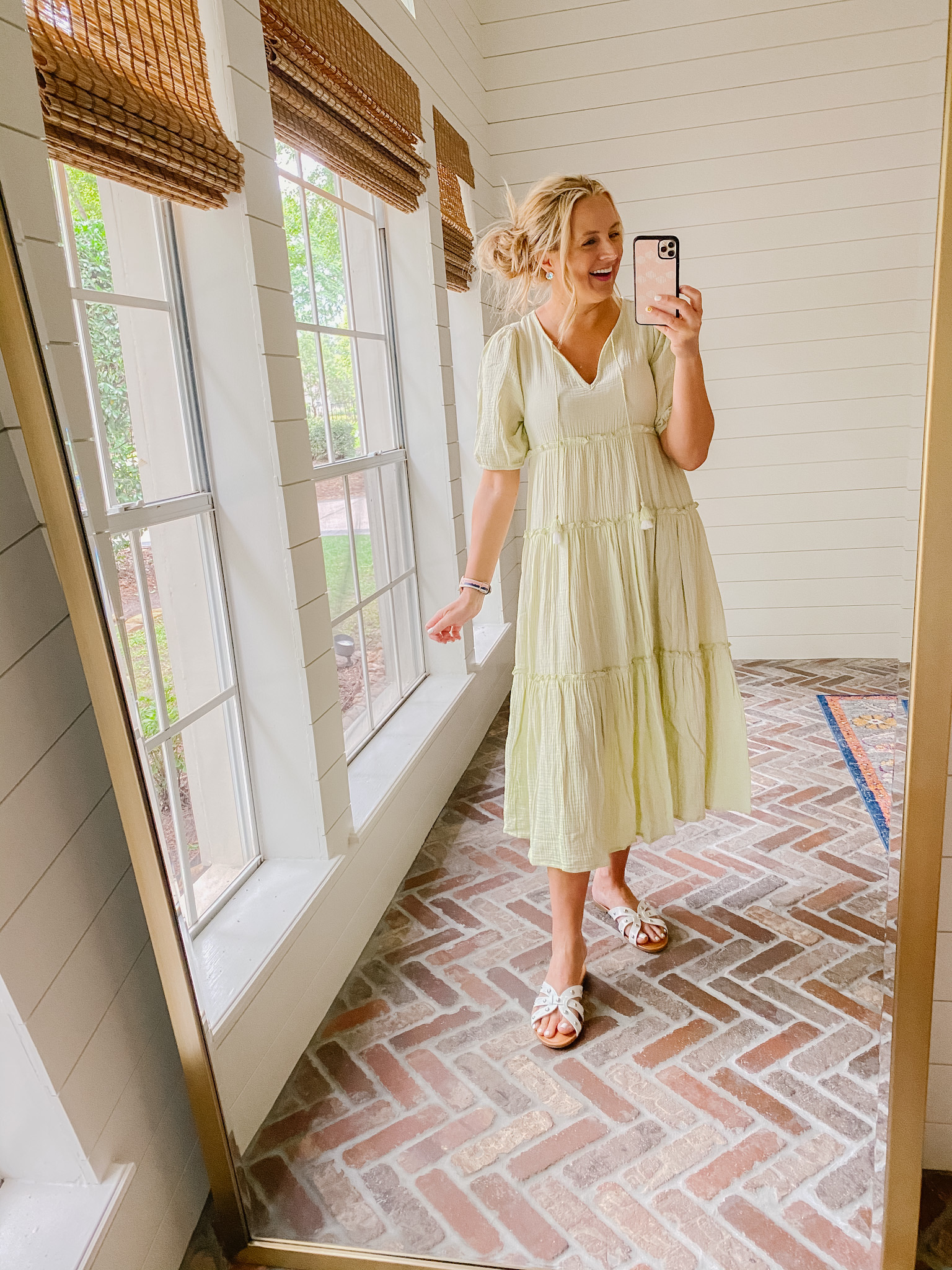 Best Sellers by popular Houston fashion blog, The House of Fancy: image of a woman wearing a yellow tiered maxi dress with white strap sandals.