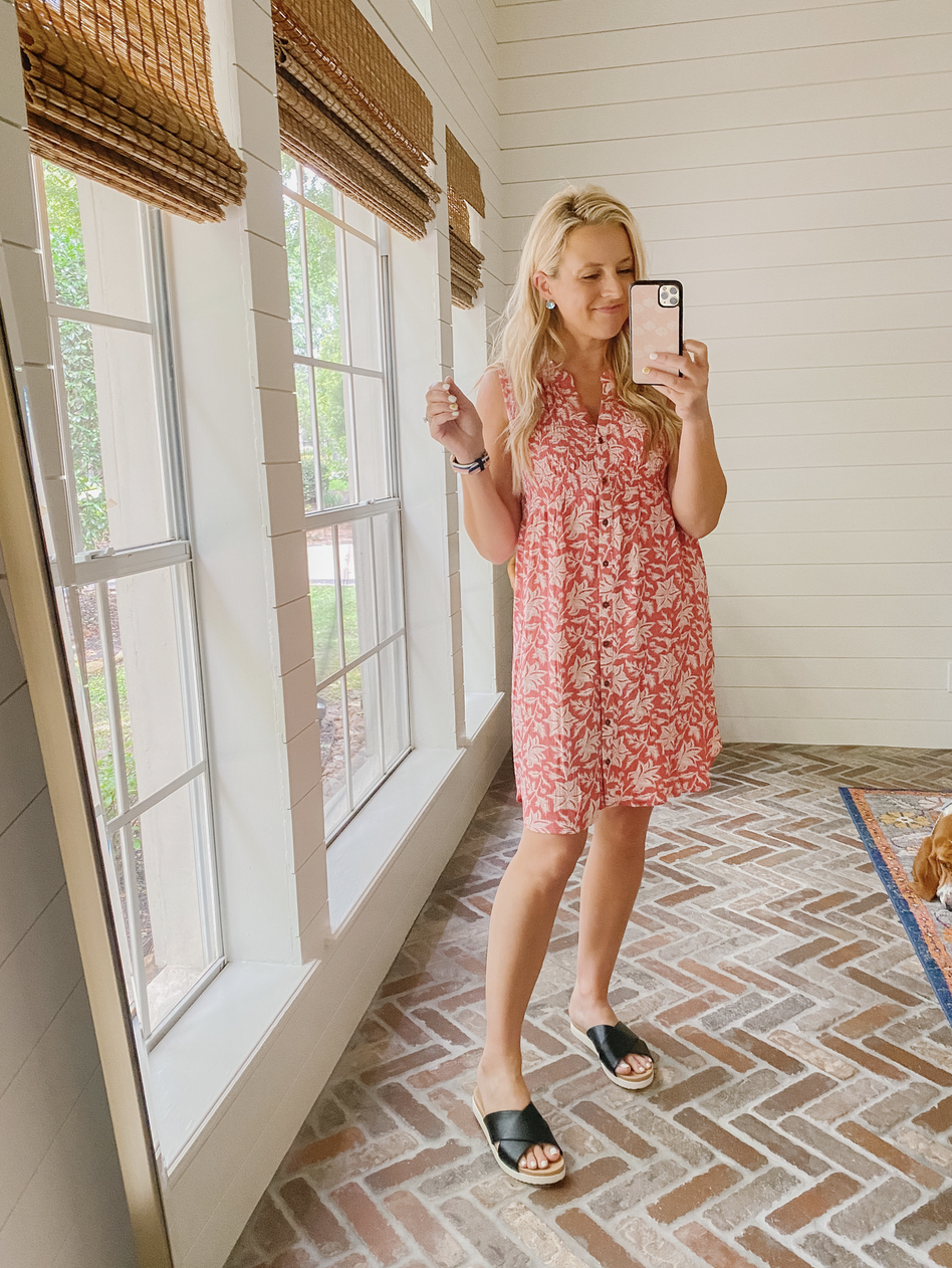 Top Sellers by popular Houston fashion blog, The House of Fancy: image of a woman wearing a red and white print button front dress with black cross strap slide sandals.