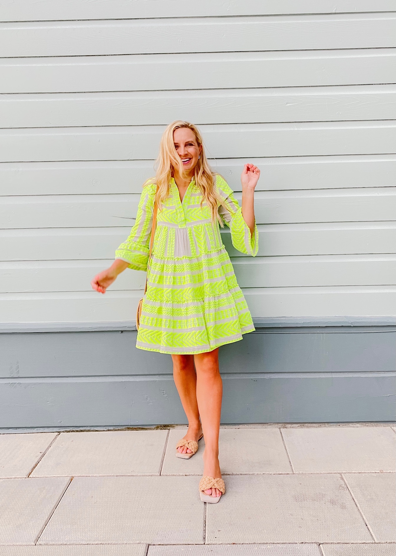 Summer Dress by popular Houston fashion blog, The House of Fancy: image of a woman wearing a yellow embroidered button front and bell sleeve dress and braided strap sandals.